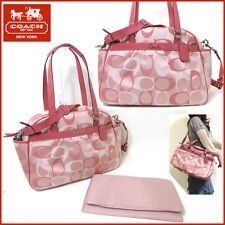 78adb354e4ea Fashionable Moms often choose to carry a Coach diaper bag. Not only are  these great looking designer bags