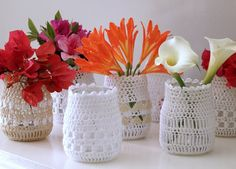 Jam Jars covered in simple crochet to create new vases and storage containers