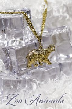 In 2007, the U.S. Congress made the 3rd week of July National Zookeeper Week. These keepers make a difference in the lives of the animals they care for every day. #QualityGold #AnimalLover #LoveMyZoo #NationalZooKeeperWeek #AnimalCharms #charms #jewelry 3 Things, Jewelry Trends, Body Jewelry, Pearl Necklace, Charms, Jewels, Gold, Animals, String Of Pearls