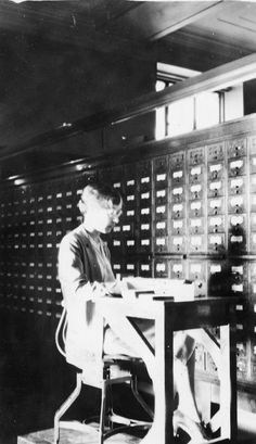 """1930s filing chair, a helpful tool  used to maintain the labor-intensive  card catalog. Folder """"Library Scenes.""""  Box 35, UM School of Information  records."""
