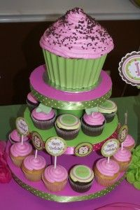 """giant cupcake on top level with matching regular cupcakes!   Used melted choc chips for """"wrapper"""""""