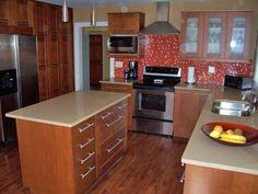 Cabinets: Maple Counter: Caesarstone Buttermilk Backsplash: Yellow glass