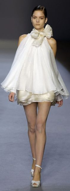 Giambattista Valli ~ Paris It is very short but oh the twirl power would have you dizzy with laughter.  It is so ethereal looking I love how oyster and white are combined.