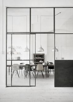 metal doors with sleek frames and a square profile add attitude to a minimal space