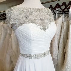Justin Alexander 8799 has never looked this sparkly! The art deco beaded neckline will make any bride shine on her wedding day.