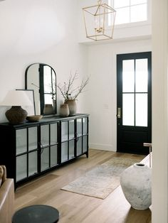 Kidd Entry Reveal (plus, sources!) — Light & Dwell Monochrome black and white hallway featuring black front door, large mirror and black upcycled cabinet Black And White Hallway, Black And White Interior, Black Door, Hallway Decorating, Entryway Decor, Modern Entryway, Bedroom Decor, Modern Staircase, Entry Foyer