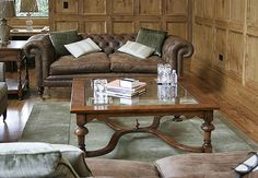 Glass top square, crinoline stretcher, coffee table and lamp table, in oak panelled room.
