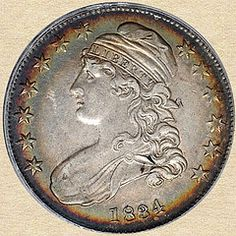 """Nice example of an 1834 Capped Bust Half Dollar. This coin is of the type 1 variety and, though you can't see it, has a lettered edge. The edge reads """"FIFTY CENTS OR HALF A DOLLAR"""". I particularly like the halo toning around the edge. Very nice coin!"""