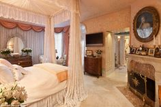 Elegant: The bedroom, complete with a four poster bed and lacy drapes and a permanent stock of fresh lillies, is 'as elegant and beautiful as she was', the realtor said