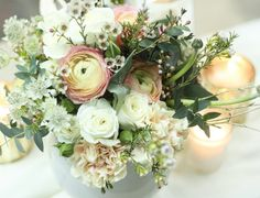 A lux cluster of blooms in a small fishbowl | Rananculus, Astrantia, Wax Flowers, Freesias, Spray Roses, Carnation