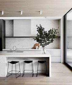 #repost @est_living #welovenew  A beautiful kitchen, we love the smooth stone kitchen island and minimalist feel to this space.   #kitchendesign #kitchendecor #kitcheninspo #kitcheninterior #dreamkitchen #homeideas #interiorinspiration #homestyle #homeinspiration