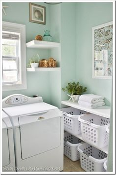 SW 6211 Rainwashed by Sherwin Williams - beautiful, refreshing, greenish blue laundry room color. Basket sorting area is also very handy. Love everything about this room makeover from Sand and Sisal