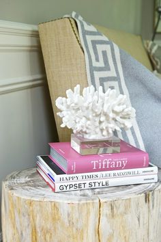 decorative coral on lucite base, greek-key throw