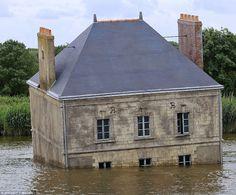 That sinking feeling: 'La maison dans la Loire' (The house in the Loire river), is one of nine installations for the art festival in Nantes, France