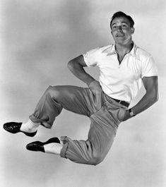 "Gene Kelly, 1952 ""You dance love, and you dance joy, and you dance dreams. And I know if I can make you smile by jumping over a couple of couches or running through a rainstorm, then Ill be very glad to be a song and dance man. Classic Hollywood, Old Hollywood, Hollywood Icons, Hollywood Actresses, Gene Kelly Dancing, Bailar Swing, Costume Blanc, Philippe Halsman, Dance Dreams"