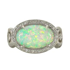 Handcrafted, One-of-a-Kind Fire and Ice III Ring in matte, hand-hammered 18k white gold with a cabochon-cut, white Ethiopian opal (3.17cts) and a pave' diamond bezel, c. 2013