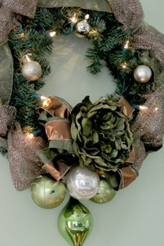 Brown and Green Christmas Wreath -- pretty.  Add the wired ribbon to your existing wreath.  Add the green flowers and brown ribbon.