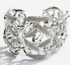 http://www.intovintage.co.uk/products-page/bracelets-bangles/silvertone-wide-bracelet/#.UwYUPoVRE7A