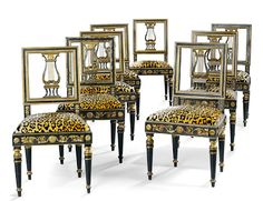 A suite of eight chairs, ebonized and giltwood, Italy.