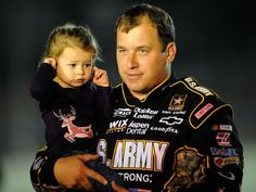 NASCAR driver Ryan Newman holds his daughter Brooklyn Sage