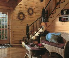 decoration captivating log cabin stair railing from black cast iron with decorative rustic wreaths mounted on wide plank wood wall paneling across wicker indoor furniture sets Small Log Homes, Log Cabin Homes, Log Cabins, Log Wall, Log Home Interiors, Log Home Decorating, Decorating Ideas, Decor Ideas, Wood Panel Walls