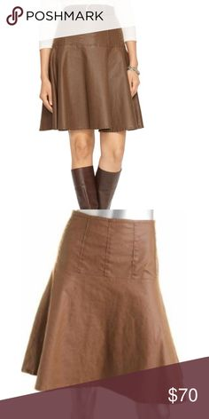 "Lauren Jeans Co Twirl and Flair Skirt 98% cotton 2% elastane Brown with shiny coating  side Zipper   Brand New With Tags   The length is 22""  across the top laying flat measured  17"" and across the bottom is 39"" Lauren Ralph Lauren Skirts"
