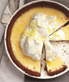 Lemon Cream Pie|Top this gingersnap cookie-crust pie with freshly whipped cream and grated lemon zest.