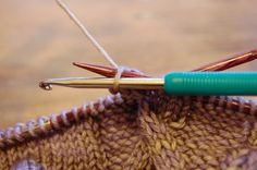 crochet bobbles in your knitting project instead of knitting them.