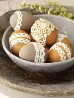 Bit of lace glued to naturally brown eggs, & to eggs painted in an earthy neutral tone.
