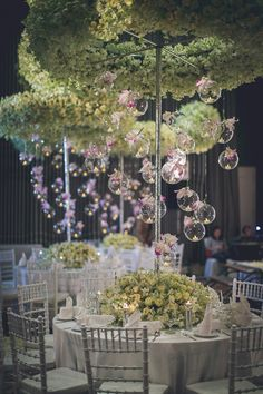 Pastel roses and purple orchids on hanging glass globes for lush wedding table decor // Wuttillert and Nattha's Luxurious Flora-Filled Bangkok Wedding