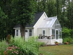 Tiny white house with sun room or greenhouse attached. So, splendid!