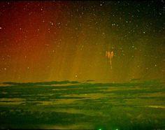 Red sprite lightning with aurora
