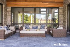 The windowed outdoor room looks over the yard and into the stunning modern home.   See more of this home in OUR HOMES Southern Georgian Bay Summer 2016: http://www.ourhomes.ca/articles/build/article/fireplace-surround-climbs-great-rooms-ceiling