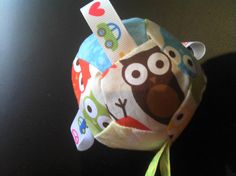 Taggy ribbon owl or flower ball with bells by ALittleViking, $14.00