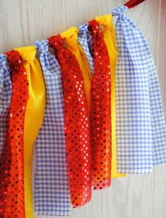 Fun Wizard of Oz inspired fabric tie garland. My garland is inspired by Dorothy's blue gingham dress, ruby red slippers and the Yellow Brick Road. The perfect touch for your Wizard of Oz Party! My gar