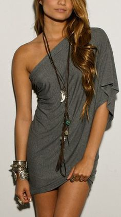 Charcoal one-shoulder dress, chunky bangles, tangled necklace and curled hair. Yes please. www.euroaka.com