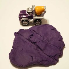 Play Dough Tire Tracks - flatten out play dough and roll toy cars and trucks on it to make tire tracks.