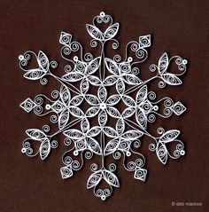 all things paper: Quilled Snowflakes. Was never interested in this quilling thing but then I saw the snowflakes, love them!