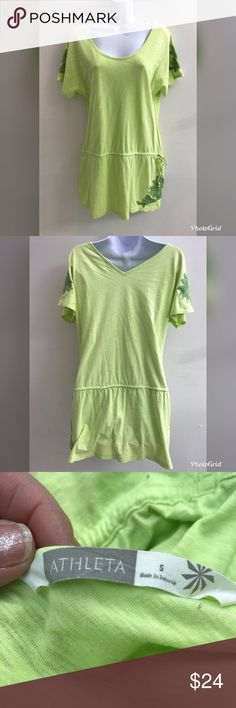 "Oversized lime green Athleta tunic Fun oversized embroidered tunic. Lime green with Kelly green embroidery. Drawstring is on hips. This is a size small on a size 4 manikin. Bust 36"", waist 34"" and length 31"". Athleta Tops Tunics"