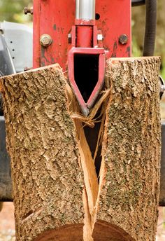 Make free firewood from your woodlot or hedgerow using a log splitter.