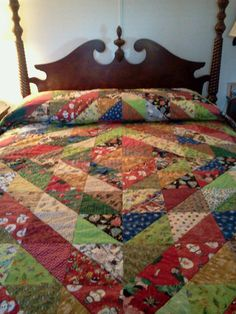"""Scrappy Christmas using a Studio Triangle 6"""" finished Quilt Block 6.  With lots of different Christmas fabric."""