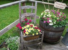Ideas for Whiskey Barrel Gardens | Old chair & whiskey barrel