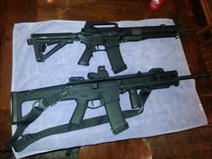 Bushmaster (top) Bushmaster ACR both magpul everything! Bushmaster Ar, Jokers Wild, You Magazine, Military Guns, Assault Rifle, Airsoft, Firearms, Weapons, Shops