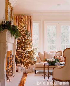 Holiday decor sparkles in the elegant, cream, gold, and blush pink living room. - Traditional Home ® / Photo: Tria Giovan / Design: Suzanne Kasler