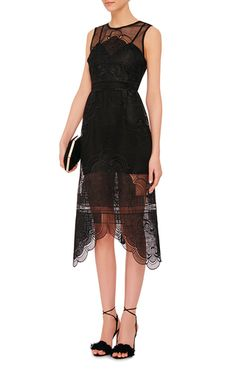A chic cocktail piece, this sleeveless **Alice McCall** dress features both scalloped and sheer panels in a figure-fitting silhouette.