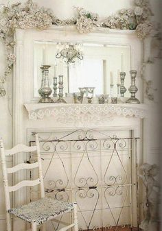 Love everything ...the lace on mantle, the grate in front of fireplace, the mirror etc.