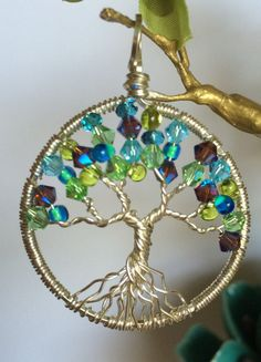 This colorful sterling silver tree features a beachy splash of colorful Swarovski Crystals and Czech glass beads. The tree is approximately 1.5,
