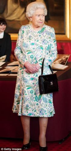 New age: The Queen wore a floral dress and black courts to the event digitalising the diaries of Queen Victori