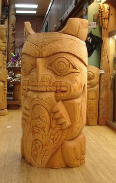 Bear with Halibut Totem by Terry Horne