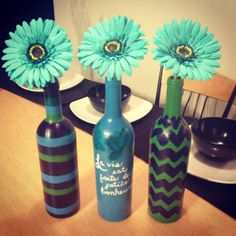 Painted wine bottles with fake flowers in them. #DIY #crafting # homedecor